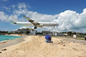 a plane lands on the island of st. martin